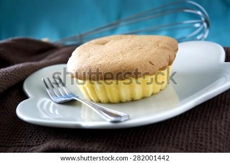 close up yummy sponge cake on dish - stock photo