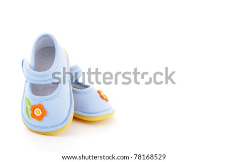 close-ups of blue baby shoes on white - baby stuff - stock photo