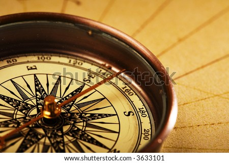 Close upview of the  compass on old map - stock photo