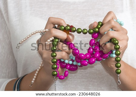 Close view of a girls hands with a jewelry  - stock photo