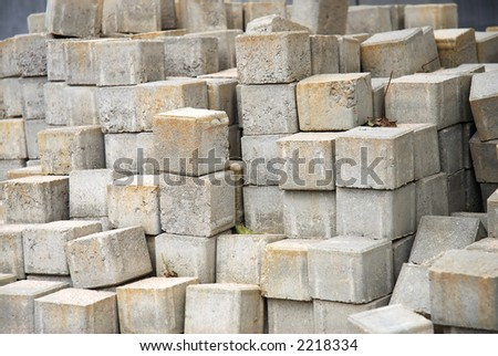 Close view of a pile of grey concrete pavers - stock photo