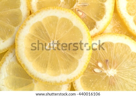 Close view of a slices of fresh lemon. - stock photo