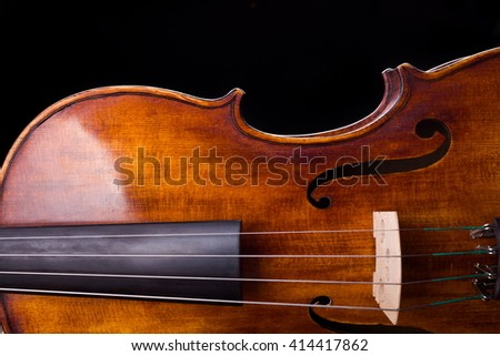Close view of a violin strings and bout on black - stock photo