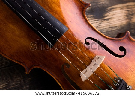 Close view of a violin strings and bridge - stock photo