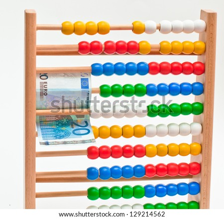 Close view of an abacus with colored beads end Euro. - stock photo