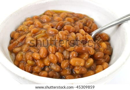Close view of baked beans in bowl with spoon - stock photo