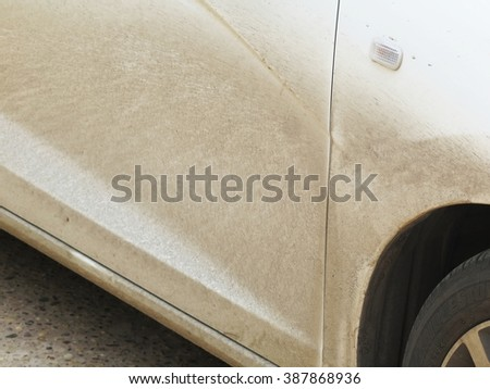 Close view of  body panel of a very dirty white car  - stock photo