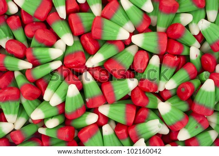 Close view of candy corn in the red green and white for holidays. - stock photo