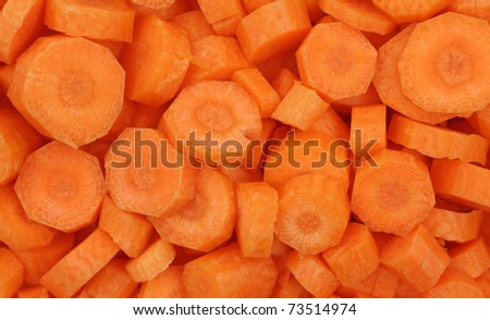 Close view of fresh organic carrots sliced.