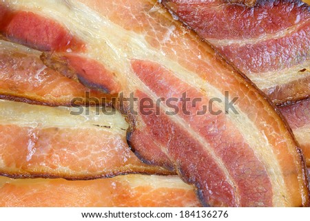 Close view of freshly cooked smoked thick sliced bacon.