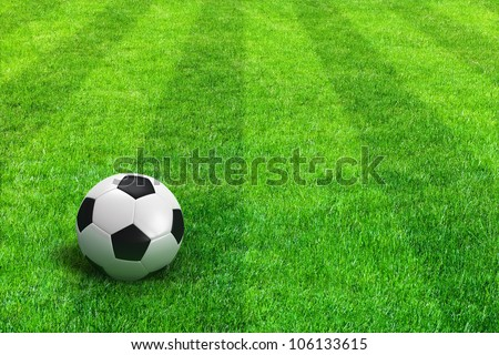 Close view of green striped football field with soccer ball