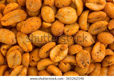 Close view of hot and spicy peanuts illuminated with natural light. - stock photo