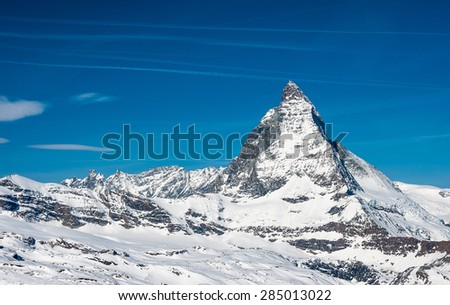Close view of Matterhorn on a clear sunny day on the winter hiking path, Zermatt, Switzerland. - stock photo