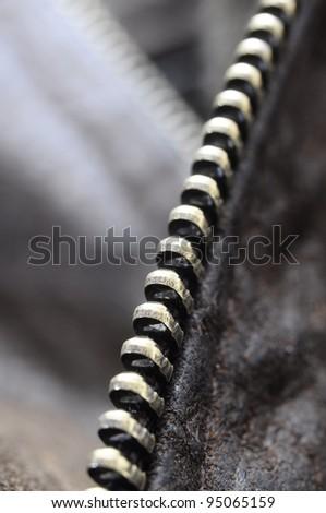 Close view of metallic zip on leather jacket - stock photo