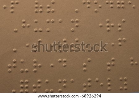 Close view of page from Braille textbook - stock photo