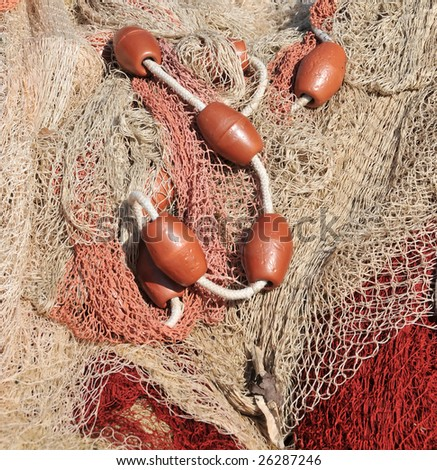 Close view of some fishing net floaters on the docks. - stock photo