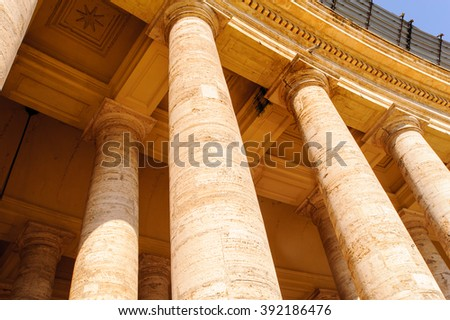 Close view of the columns of the Saint Peter's square in Vatican, Rome, Italy - stock photo