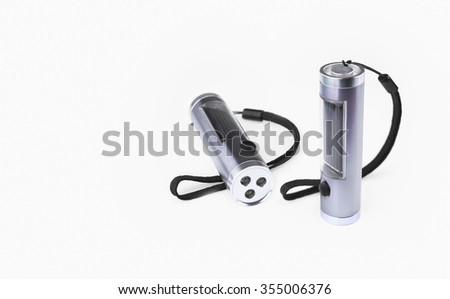 Close view of three LED  flashlight with solar battery on a white background - stock photo