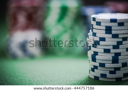 close view on casino chips stack,blurred background