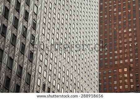 Close view on windows of builings in Manhattan, New York - stock photo