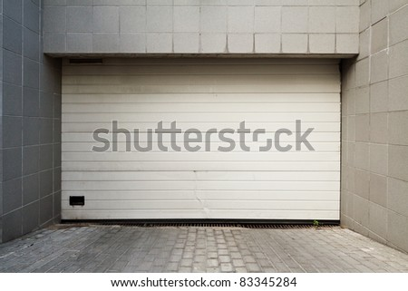 Close white garage door - stock photo