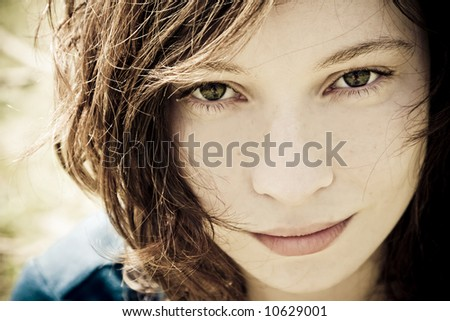 Close woman portrait with the world  reflected in her eyes.