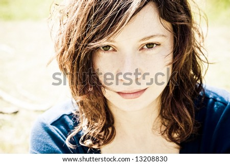Close woman portrait with the world  reflected in her eyes. - stock photo