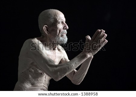 close your eyes and pray for mercy - stock photo
