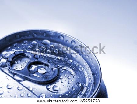 Closed aluminium jar with water drops - stock photo