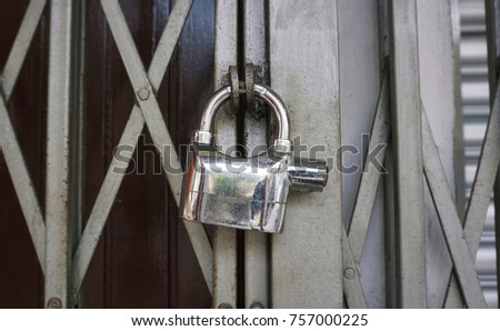 Closed and locked door grill with silver padlock. Itu0027s attached on the old building located & Closed Locked Door Grill Silver Padlock Stock Photo (100% Legal ...