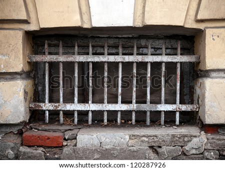 Closed basement window with lattice. Typically architecture detail for old part of St.Petersburg, Russia.