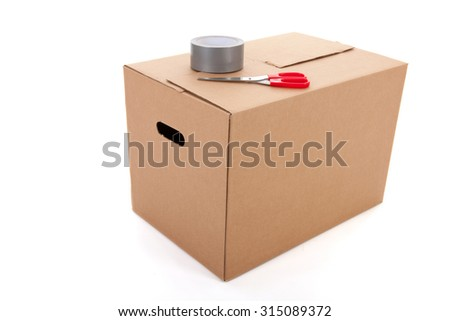 Closed box with scissors and scotch tape isolated over white background - stock photo