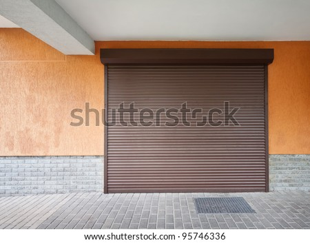 Closed brown louver door - stock photo