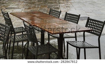 Closed cafe in rain time, Italy. - stock photo