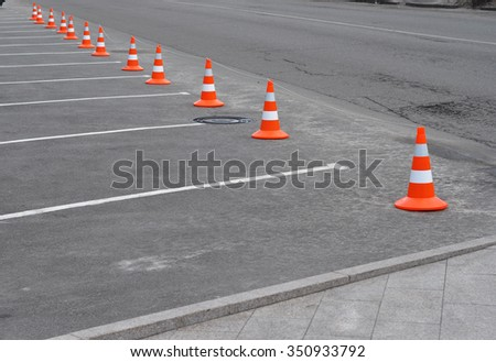 Closed car parking lot with white mark and traffic cone on street used warning sign on road - stock photo