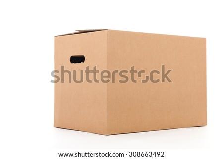 Closed carton box isolated over white background - stock photo