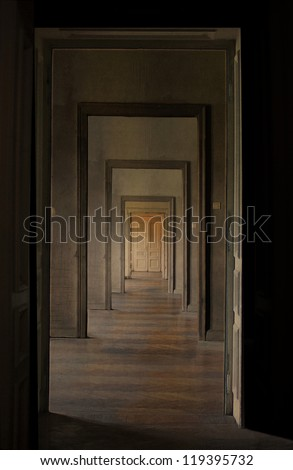 Closed door at the end of the hallway, rite of passage concept. Linear perspective view through several open doors and empty rooms. - stock photo