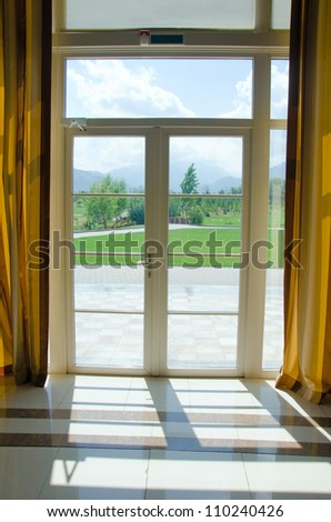 closed door to garden with curtains