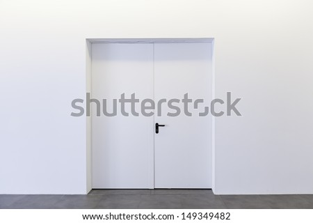 Closed door white building interior walls, construction - stock photo
