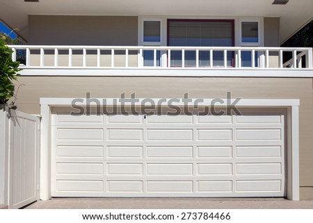 Closed double Garage in white. - stock photo