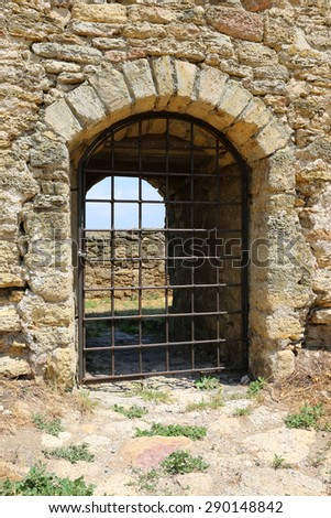 closed entrance in old castle - stock photo