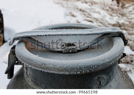 closed frozen milk bucket in the winter