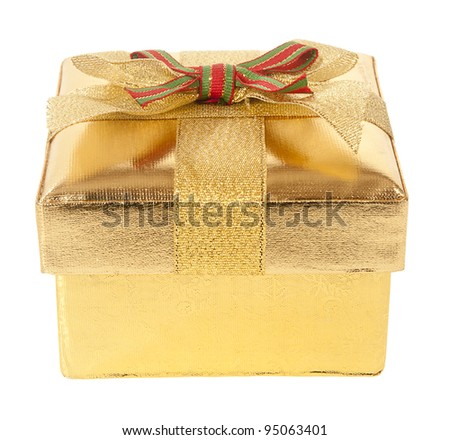 Closed gold gift box with bow and ribbon on a white background - stock photo