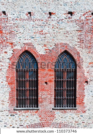 Closed  Gothic Windows on Old Brick Wall - stock photo