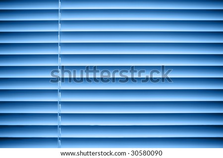 Closed jalousie at blue illumination - stock photo
