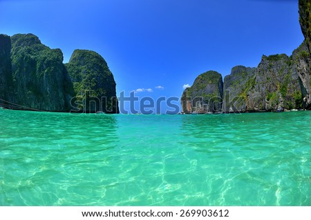 closed lagoon with cliffs and crystal clear water - stock photo