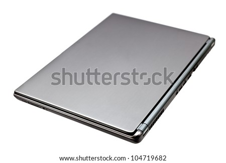 Closed laptop computer isolated on white background - stock photo