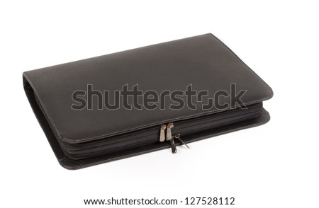 Closed luxury black leather diary or journal with a zipper isolated on white - stock photo