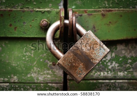 Closed metal lock door security protection padlock - stock photo