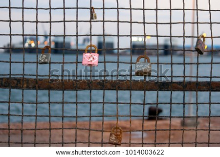 Closed metal locks on the wall around the remains of the monument of Ferdinand de Lesseps, Some lovers left it, Port Said, Egypt.